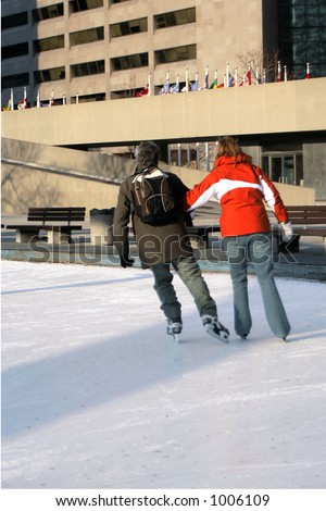 couple skating in city park - stock photo