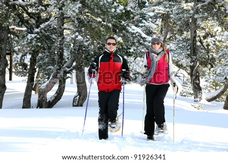 Couple skiing together - stock photo
