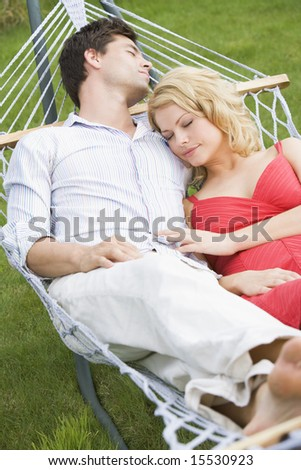 Couple sleeping in hammock - stock photo