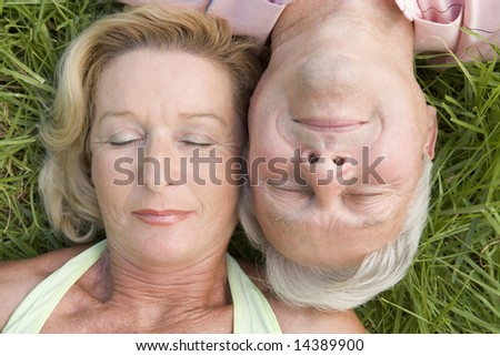 Couple sleeping outdoors