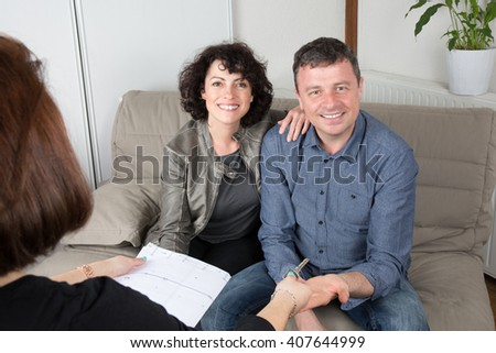 Couple, smiling and happy, receiving keys of their home
