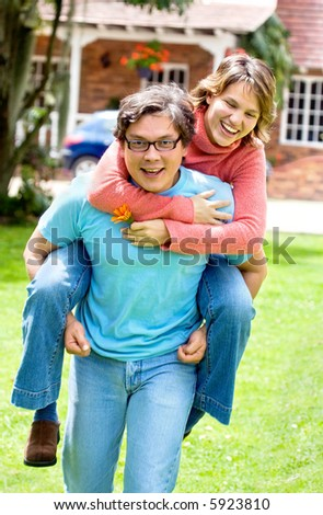 couple smiling and having fun outdoors at home - stock photo