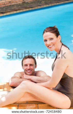 Couple smiling at the swimming pool