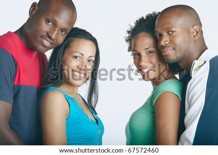 Couple smiling for the camera together - stock photo