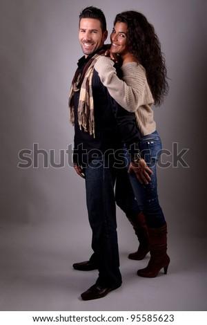 couple smiling in studio portrait - stock photo
