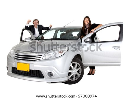 Couple smiling with a car isolated over a white background - stock photo