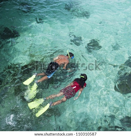 Couple snorkeling with crystal clear water