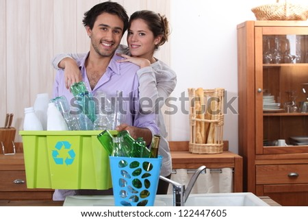 Couple sorting the recycling - stock photo