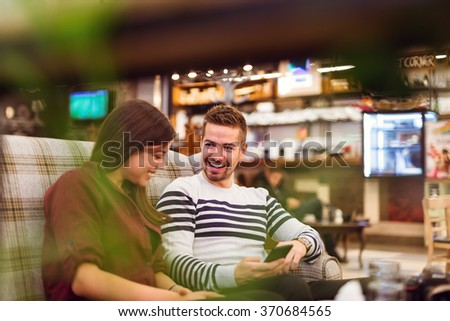 Couple spending some quality time together in a cafe.