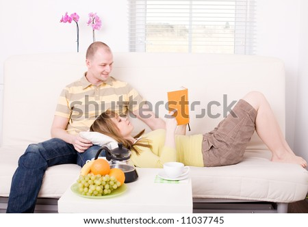 Couple spending time together. Relax at home. - stock photo