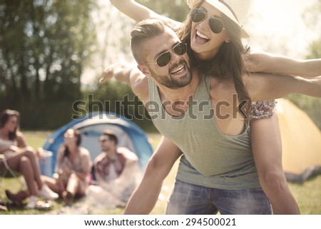 Couple spending weekend with their friends - stock photo