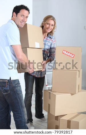Couple stacking boxes - stock photo