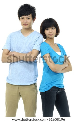 Couple standing back to back - stock photo