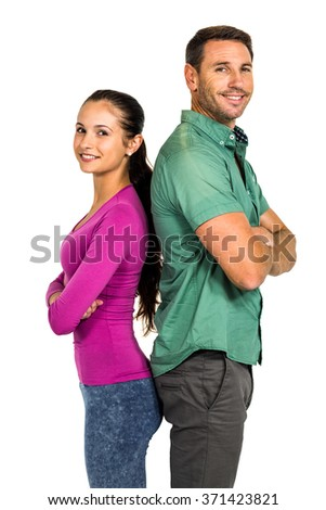 Couple standing back to back and smiling at the camera on white screen - stock photo