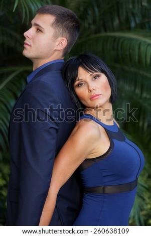 Couple standing back to back stock image - stock photo