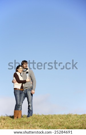 Couple Standing In The Park - stock photo