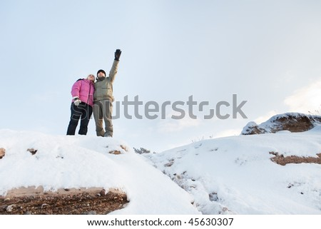 Couple standing on the steep slope - stock photo