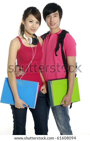 Couple standing with books and bags,