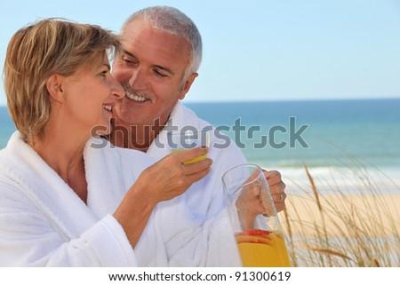 Couple stood at the beach - stock photo