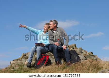Couple Stopping For Lunch On Countryside Walk - stock photo