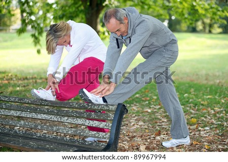 Couple stretching before run - stock photo