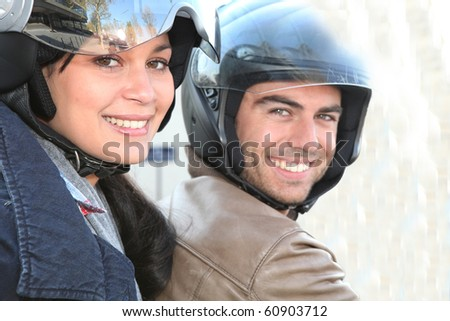 Couple strolling on motorcycle