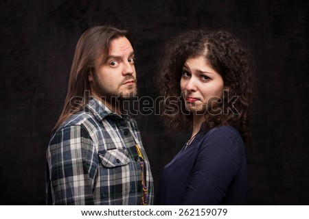 Couple taking a selfie photo on dark background - stock photo