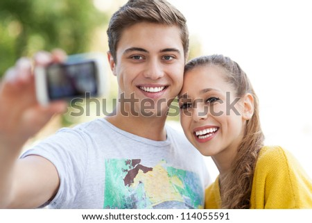 Couple taking photo of themselves - stock photo