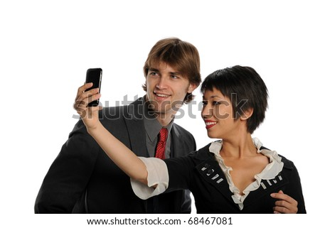 Couple taking photo with cell phone isolated on a white background - stock photo