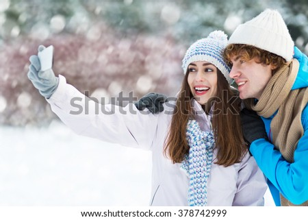 Couple taking picture of themselves  - stock photo