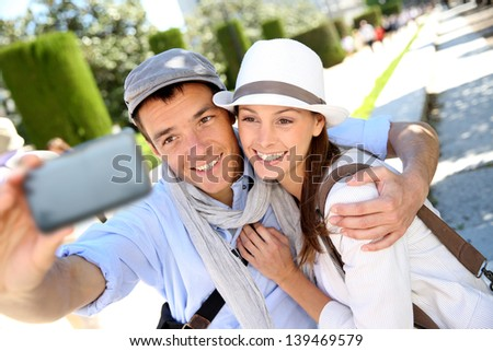 Couple taking picture of themselves with smartphone - stock photo