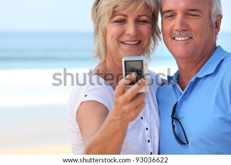 Couple taking self-portrait - stock photo
