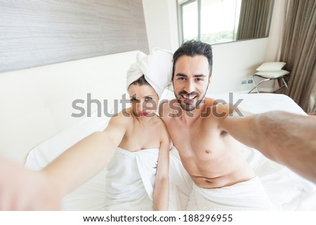 Couple Taking Selfie after Shower - stock photo