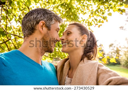 couple taking selfmade photo on sunny day - stock photo