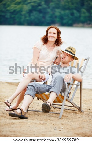 Couple taking vacation together on a beach in summer - stock photo