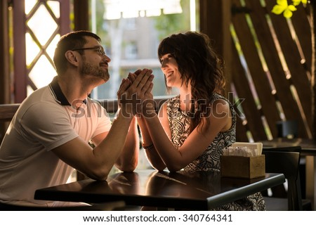 Couple talking at outdoor cafe - stock photo