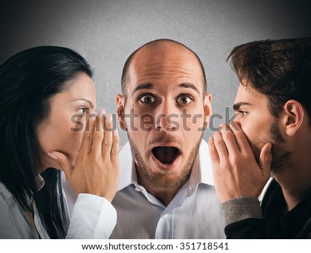 Couple talking in secret to a man - stock photo