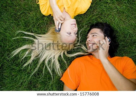 Couple talking on mobile phones - stock photo