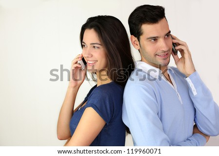 Couple talking on the mobilephone - stock photo