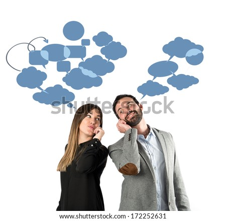 Couple talking to mobile over isolated background.