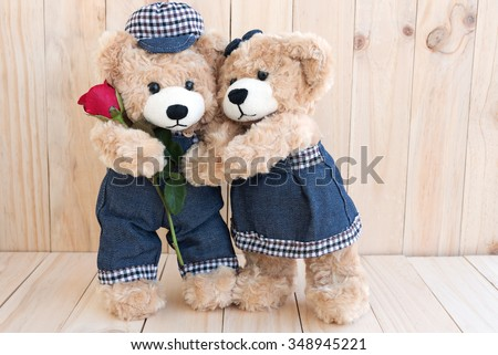 couple teddy bears with rose on wood background, two teedy bear love concept for valentines day, wedding and anniversary - stock photo