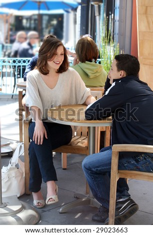 Couple teenagers having a good time in a city - stock photo