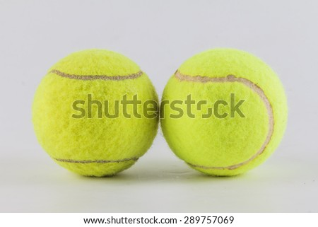 Couple tennis balls isolated on white background