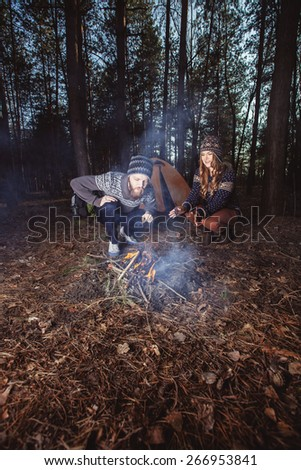 Couple tent camping in the wilderness - stock photo
