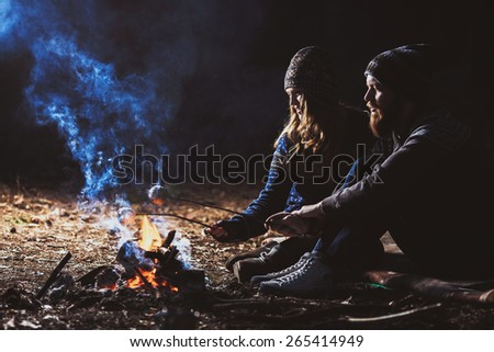 Couple tent camping in the wilderness, low key, soft focus - stock photo