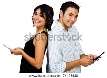 Couple text messaging on mobile phones and smiling isolated over white