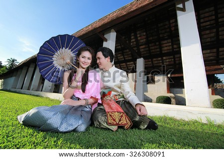 Couple thai dress in the old temple