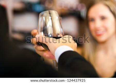 Couple toasting wine glasses - stock photo