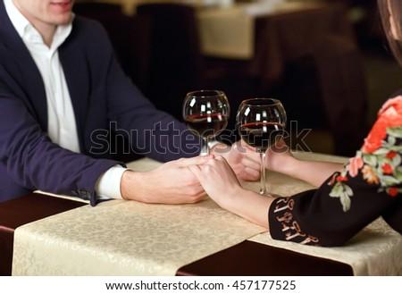 Couple toasting wineglasses  - stock photo