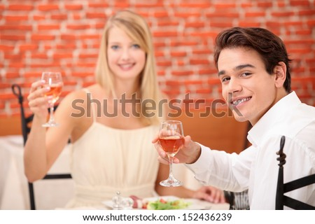 Couple toasting with pink wine - stock photo
